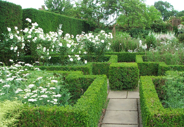  With lots of green box hedges. 