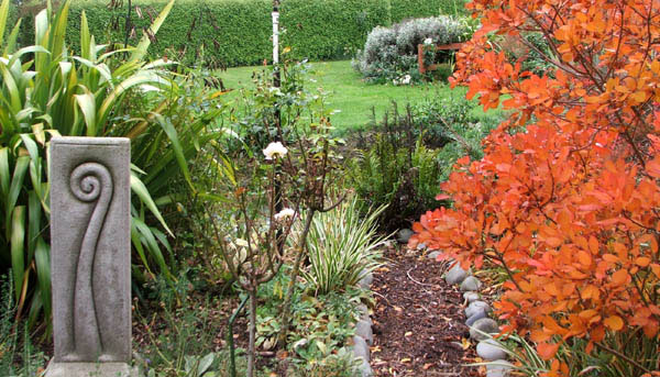 With a purple smoke bush going brilliantly orange.