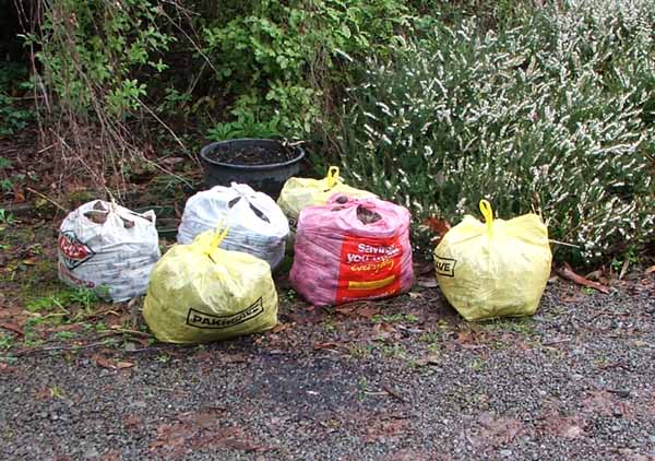 I pick up the bags free from the road-side.