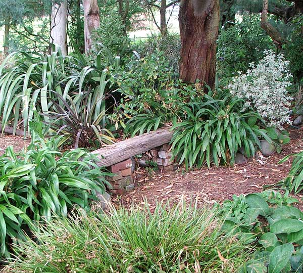 The seat is on the main Wattle Woods path.