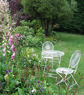 By the white garden furniture.