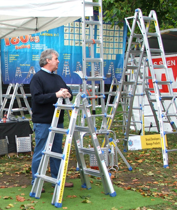 A Flower Show stall-holder looks for customers.