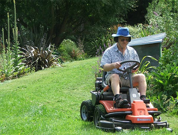 A well-dressed lawn mower man.