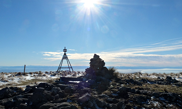 A cairn and a trig and the low winter sun.